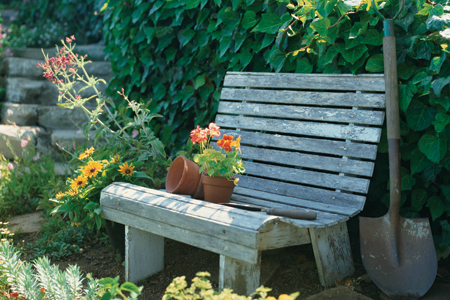 finished garden bench with garden tools