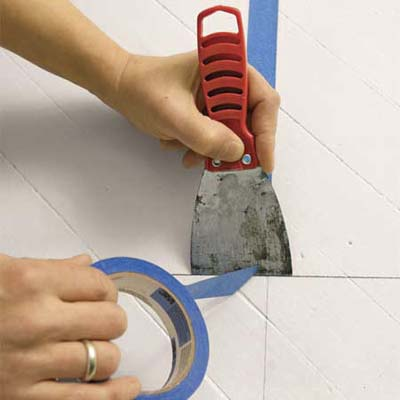cutting painter's tape with a putty knife
