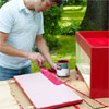 this old house editor mark powers painting the wooden box red both inside and out