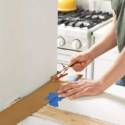 using a compass and utility knife, cut the cardboard strips exactly to size and shape