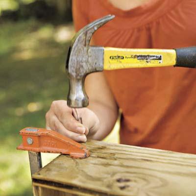 woman hammering nail