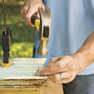 man using nail and hammer
