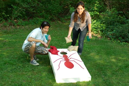 man and woman playing cornhole