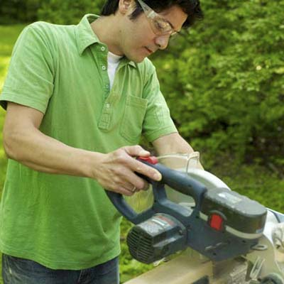 man using miter saw