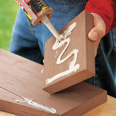 applying construction adhesive to boards