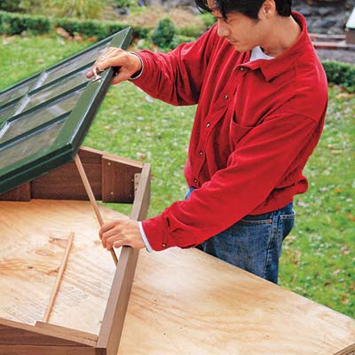 vent rod used to prop open the lid of the cold frame