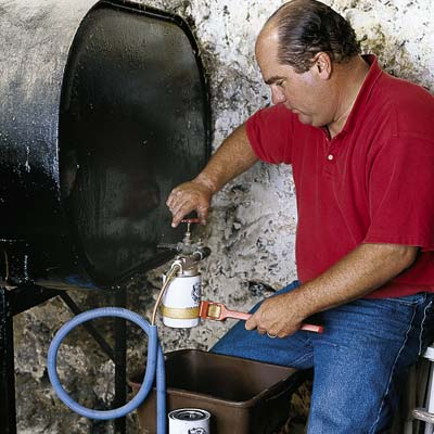 man replacing oil filter of furnace