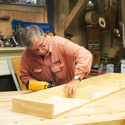 Tom Silva assembles the shelving unit base
