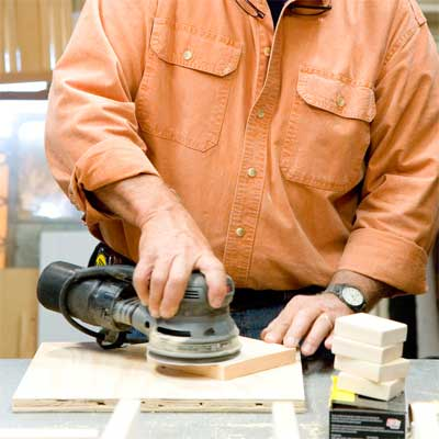 this old house general contractor sanding and painting the pieces to build a freestanding lamp