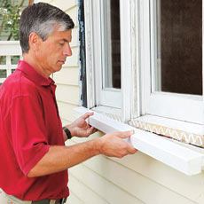 Man installing new windowsill