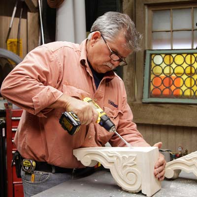 Tom Silva drills a recess into the corbel for a trestle table using a drill/driver with a 5/8-inch paddle bit