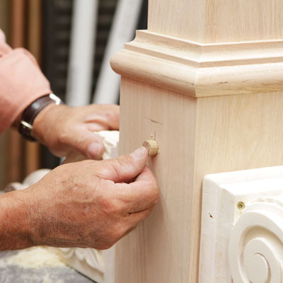 Tom Silva plugs a recess in the table leg for a trestle table with a wood plug made from a 5/8-inch dowel
