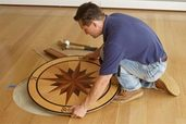 man installing a floor medallion