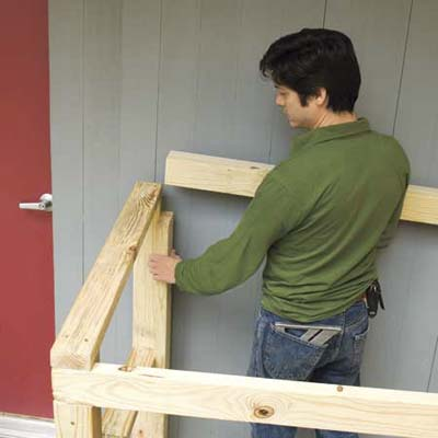 Mark Powers installing the back crosspiece for his trash shed