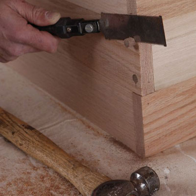 cutting the dowels with a flush-cut saw