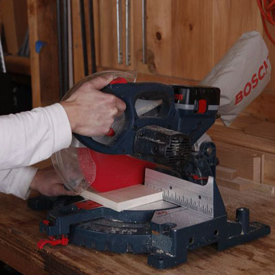 cutting a frame piece with a miter saw