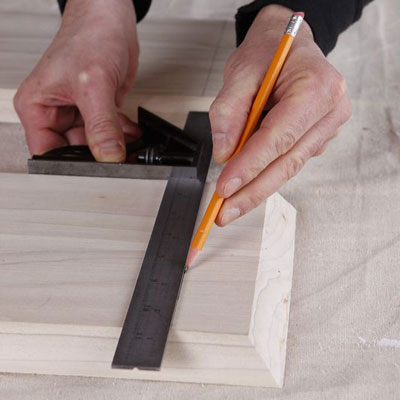 marking the side's location onto the top board with combination square and a pencil