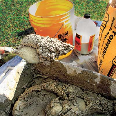 mixing up the new mortar to repair a stone walkway