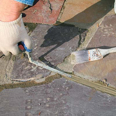 packing down mortar with a tuck-pointing trowel