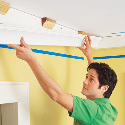 installing the first run of three-piece crown molding