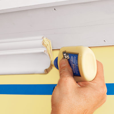 applying glue to a scarf joint to attach to three-piece crown molding