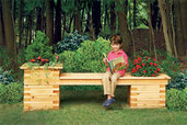 child enjoying a seat on an outdoor planter bench on a beautiful day