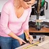 measuring the door to mark the trim cutlines