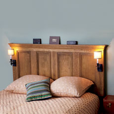 an interior door made into a headboard