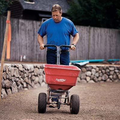 Roger Cook rototills the soil