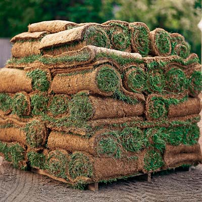 a high stack of rolled sod
