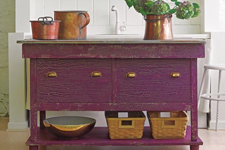 a kitchen island with faux crackle