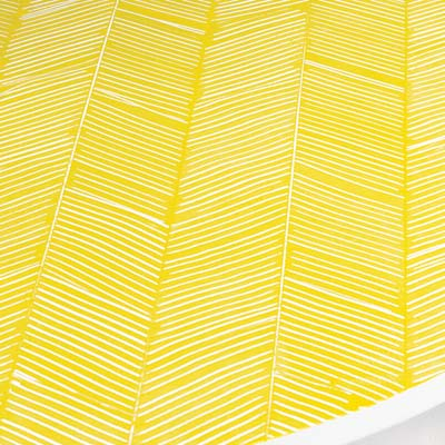 a yellow herringbone pattern on a tabletop