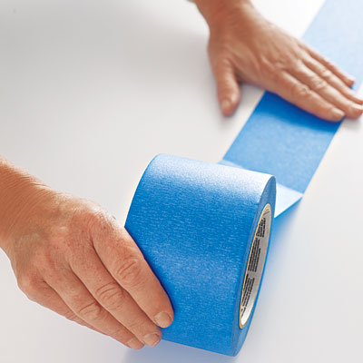 laying the first row of painter's tape on a table surface
