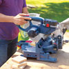 Mark Powers cuts pieces for a hypertufa table with a miter saw
