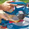 Mark Powers cuts boards to use for the structure for the hypertufa table with a miter saw