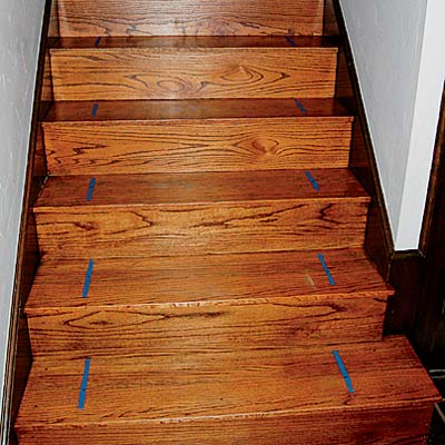 painter's tape used to mark the stairs to center the easy to install stair runner