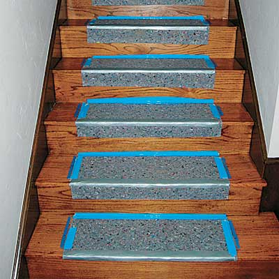 padding adhered with double sided carpet tape  for this easy to install stair runner