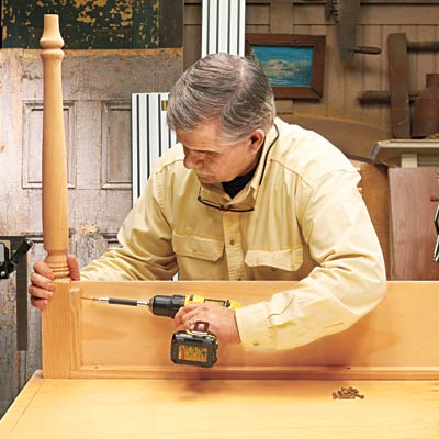Tom Silva attaches the base to the table legs