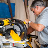 Tom Silva cuts strips for the front bottle insert with a miter saw