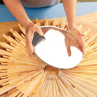 attach the mirror when making a sunburst mirror frame with wood shims