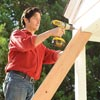 person adding supports to porch awning