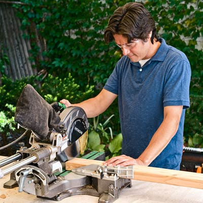 cutting a 2x4 with a compound miter saw