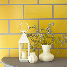 a wall painted in faux subway tile pattern