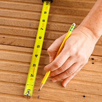 measuring tongue-in-groove flooring to use as recessed shelving