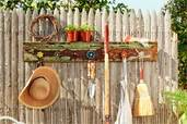 finished project from How to Build a Spigot-Handle Tool Rack installed on a picket fence