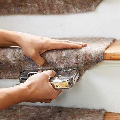 Staple the Padding to the Steps to Install a Flat-Weave Cotton Stair Runner