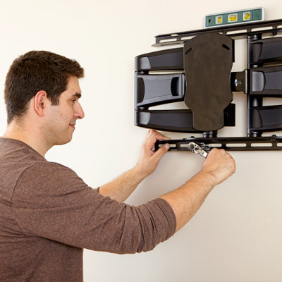 installing wall mount for hanging a flat-screen tv