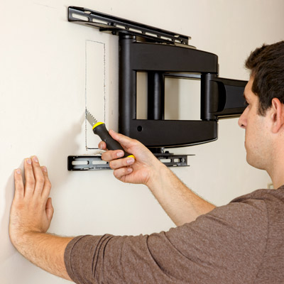 cutting receptacle hole in drywall for hanging a flat-screen tv