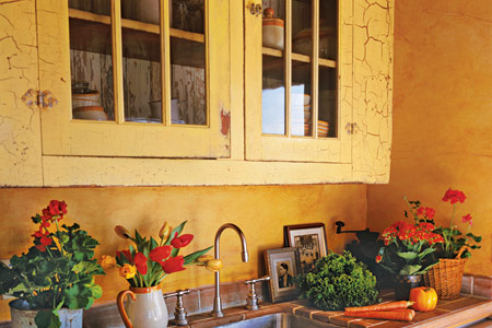 yellow crackled painted kitchen cabinets with painted hinges