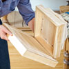 gluing the boxes together to secure the base